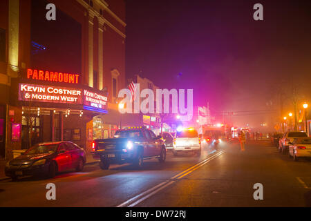 March 1, 2014 - Huntington, New York, U.S. - A large  fire rages in the heart of Huntington village, down the block from the famous Paramount Theater, on New York Avenue. Firefighters came from many surrounding towns of Suffolk County, Long Island, and huge clouds of smoke lit up the night sky for blocks. Credit:  Ann E Parry/Alamy Live News - Stock Image