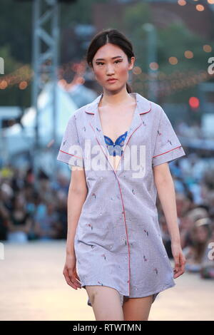 Montreal,Canada.  A model walks on the runway at the Lilianne lingerie  fashion show held during the Fashion and Design Festival. - Stock Image