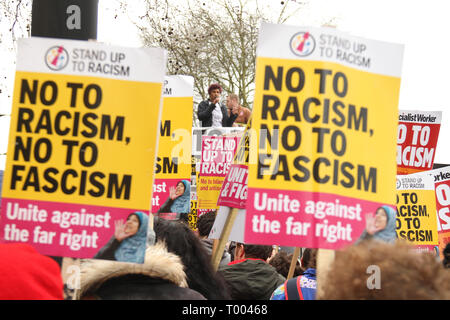 London, UK - 16 March 2019: Speakers address the gathered demonstrators at Park Lane ahead of the march to Downing Street. Thousands of people took part in the UN Anti-Racism Day demonstration that took place in central London on 16 March. The demonstration which began in Park Lank and ended outside Downing Street was organised by Stand Up to Racism and Love Music Hate Racism and supported by the TUC and UNISON. Photo: David Mbiyu Credit: david mbiyu/Alamy Live News - Stock Image