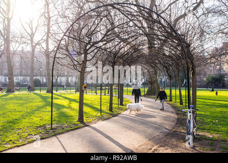 Russell Square, London, UK - February 2017. People in Russell Square, a large garden square in Bloomsbury, in the London Borough of Camden - Stock Image