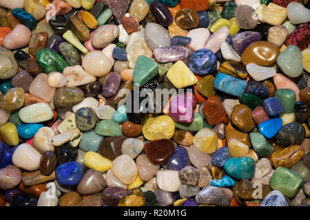 Assortment of multi colored pebbles. - Stock Image