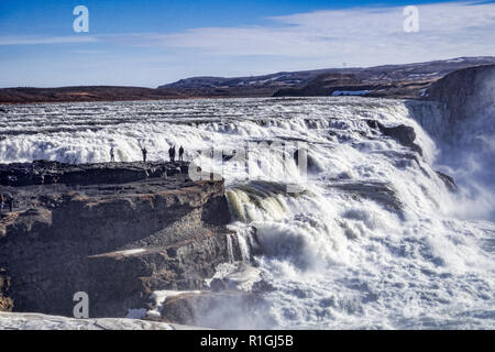 20 April 2018: Gullfoss, Iceland - Visitors at the top of Gullfoss waterfall, one of the main tourist attractions in southern Iceland. - Stock Image