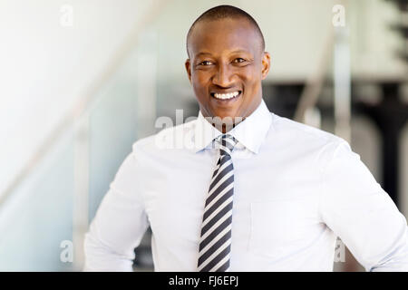 handsome African man looking at the camera - Stock Image