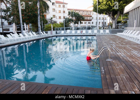 Santa Cruz de Tenerife; taking a swim in the pool of a five star hotel. - Stock Image