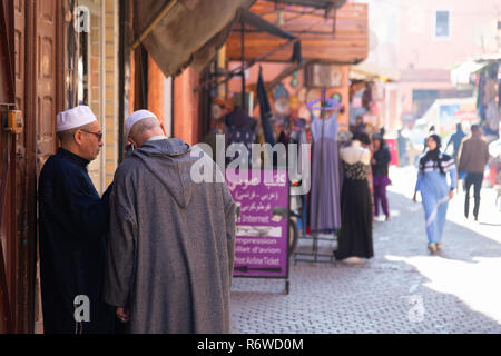 Marrakech street scene with local moroccan people, the Medina, Marrakech, Morocco North Africa - Stock Image
