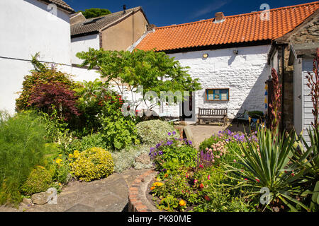 UK, England, Yorkshire, Filey, Queen Street, town museum yard and back garden - Stock Image