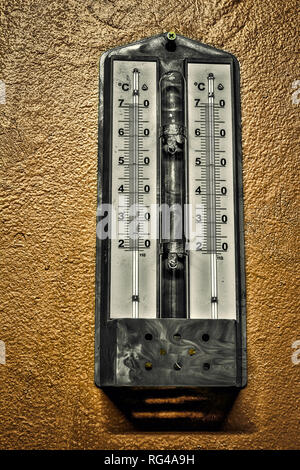 Thermometer on wall outside,wall thermometer, temperature measurement, outdoor temperature, weather conditions - Stock Image