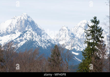 View across Lake Alpsee showing the mountains from left to right of Gehrenspitze, Kollenspitze, Haldensee, Tannheimer Berge, Bavaria, Germany - Stock Image
