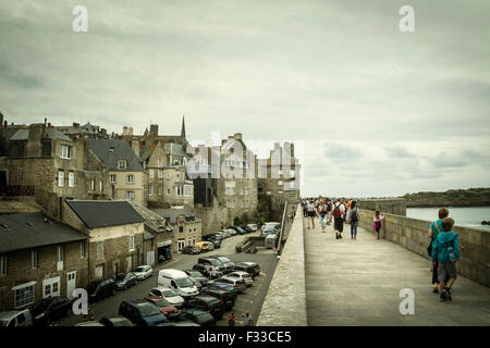 People walking, old medieval and historic town, Saint Malo, Brittany, France, Europe. - Stock Image