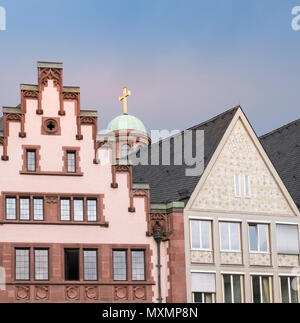 Traditional exterior of Romer Old Town City Hall, with the dome and cross of St Pauls Church in the background, Frankfurt am Main, Hesse, Germany. - Stock Image