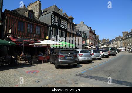 Half timbered buildings and shops in Grande Rue des Stuarts, Dol de Bretagne, Ille et Vilaine, Brittany, France - Stock Image