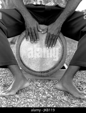 A Bele drummer plays his drum.. Fort de France, Martinique. Caribbean. - Stock Image