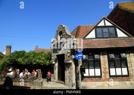 The Old Bell (aka Ye Old Bell) Pub and customers sitting outside enjoying the sunshine, The Mint, Rye, East Sussex, United Kingdom - Stock Image