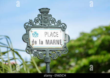 French colonial style sign showing the name 'Place de la Marne', the central square / plaza in Noumea, capital - Stock Image