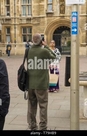 Asian man taking photo of Asin woman Cambridge 2019 - Stock Image