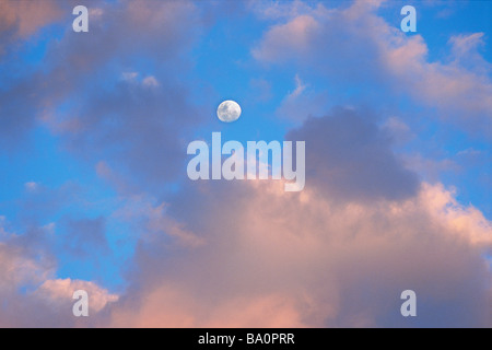 Clouds and 3 4 moon - Stock Image
