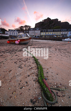 Boat moored on the beach at Gorey, Chanel Islands - Stock Image