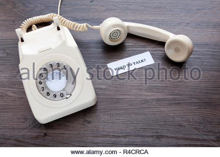 Retro telephone with note - Need To Talk? - Stock Image