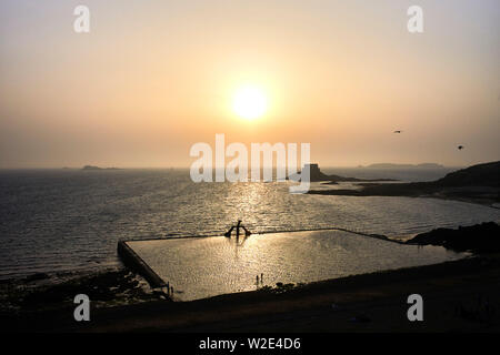 Seaside tidal swimming pool viewed from the walls at St Malo, Brittany, France - Stock Image