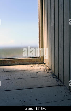 Interior image of a window in an old abandoned building - Stock Image