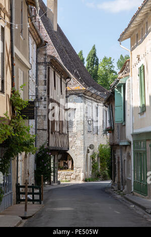 Street scene in the centre of Issigeac , a medieval bastide town in the dordogne, France europe - Stock Image