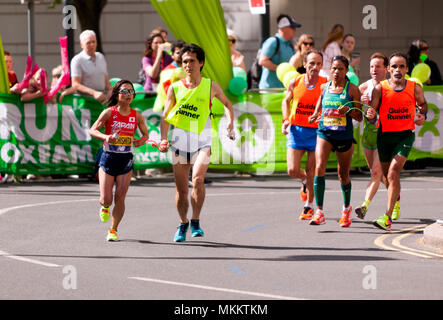 Misato Michisita (JPN)  and Edenusa  De Jesus Santos Dorta, (BRA),   competing in the World Para Athletics World Cup, Part of the 2018 London Marathon - Stock Image
