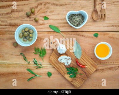 Different sorts of cooking oil,olive oil flavored and Sesame oil with  spices herbs rosemary ,thyme,dill,sage mint - Stock Image