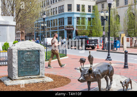 ASHEVILLE, NC, USA-4/11/19: A man walks through the Broadway entrance to Pack Square includes a monument to Robert E. Lee and animal sculptures. - Stock Image
