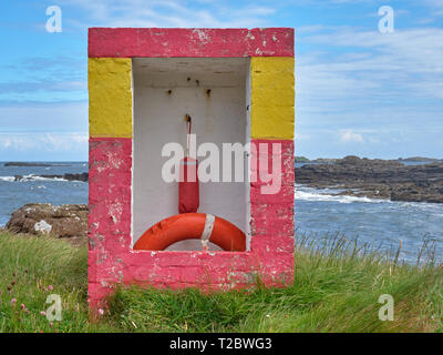 Emergency floating device in a brick box of the coast of Northern Ireland - Stock Image