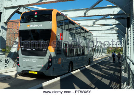 A Metrobus travels over the former rail/road Ashton Avenue Bridge, now a guided busway/cycle & pedestrian route. Bristol, UK. - Stock Image