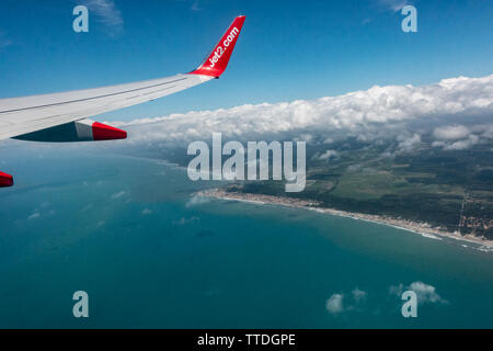 View of the mediterranean coast from a cabin window of a Boeing 737 above the clouds - Stock Image