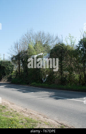 Discarded plastic waste snagged on roadside trees in Buckinghamshire. - Stock Image