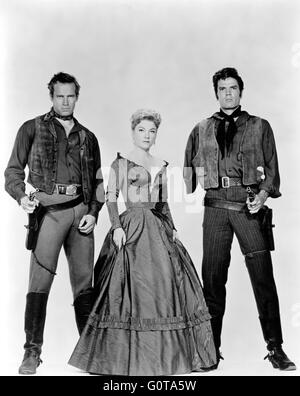 Charlton Heston, Anne Baxter and Tom Tryon / Three Violent People / 1956 directed by  Rudolp Maté (Paramount - Stock Image