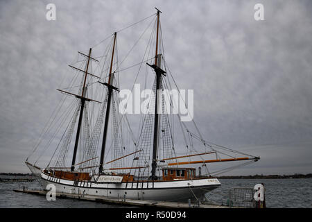 Empire Sandy tall ship moored at Toronto Harbourfront Centre with rigging against cloudy sky and Toronto Islands - Stock Image