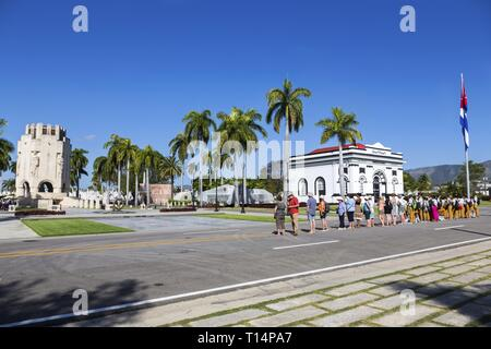 Group of Tourists Santa Ifigenia Military Cemetery Standing in Row Watching Change of Guards Ceremony by the Grave of Fidel Castro in Santiago De Cuba - Stock Image