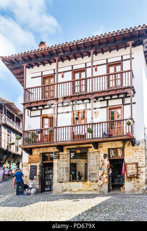 Santillana, Spain - 8th July 2018: Shop in historic building. There are many such buildings in the town. - Stock Image