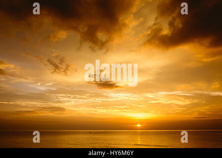 Beautiful sea sunset with deep cloudy sky - Stock Image