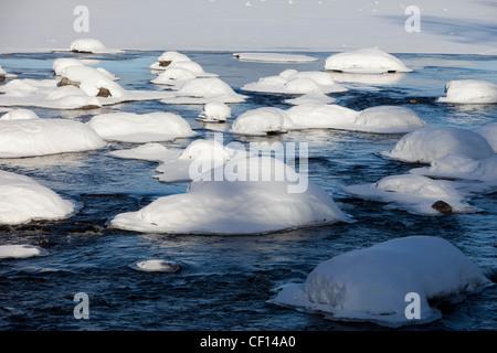Snowy rocks in river , Finland - Stock Image