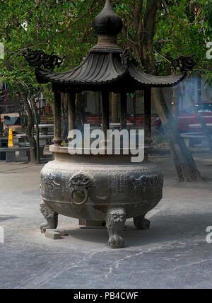 Incense burning at the Po Lin Buddhist Monastery located on Ngong Ping Plateau,  Lantau Island, Hong Kong China - Stock Image