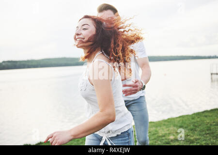 Loving funny playful happy couple on the beach. - Stock Image