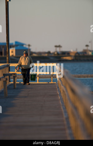 Fisherman on a pier at the sunset in Rockport, TX US - Stock Image