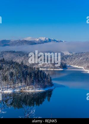 Lokve lake in Croatia winterscape landscape during Winter Risnjak mountain in background - Stock Image