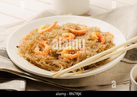 Сellophane noodles stir-fried with shrimps on a table - Stock Image