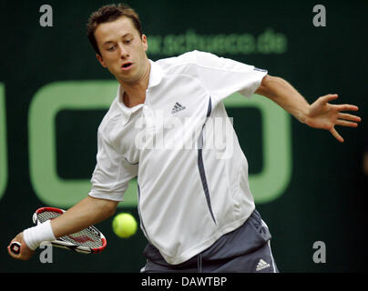 German tennis pro Philipp Kohlschreiber hits a forehand in his quarter-finals match against seeded US James Blake - Stock Image
