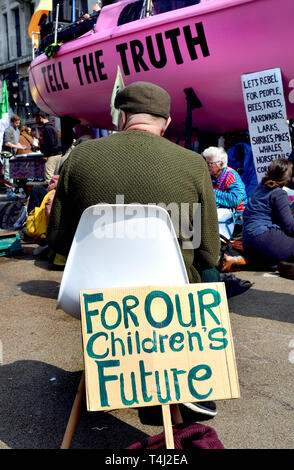 London, UK. 17th April, 2019. Environmental campaign group Extinction Rebellion bring traffic to a standstill in central London for the third day running, camping out in several locations around the city, to demand that the Government take emergency action on the climate and ecological crisis. Oxford Circus. Credit: PjrFoto/Alamy Live News - Stock Image