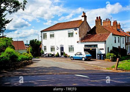 Period house and Peugeot 205 convertible car, Sadberge, Borough of Darlington, England - Stock Image