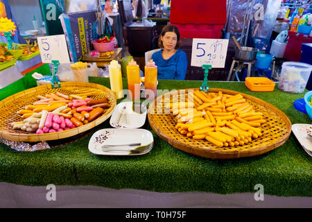 Sausage seller, Star Night Bazaar, night market, Rayong, Thailand - Stock Image