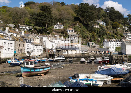 Boats in the harbour at Polperro in Cornwall, England, UK - Stock Image