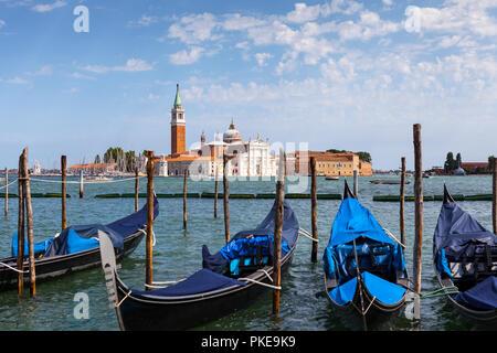 Gondolas in Venice, moored opposite San Giorgio Maggiore; Venice, Italy - Stock Image