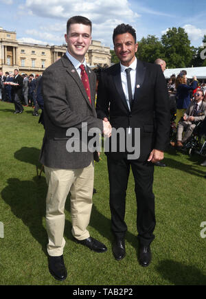 Peter Andre (right) with Matthew Hillier, aged 20, and the youngest veteran in attendance, during the Not Forgotten Association Annual Garden Party at Buckingham Palace in London. - Stock Image